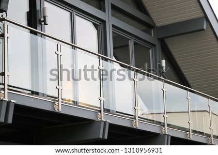 Balcony railing made of glass and stainless steel