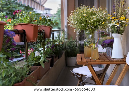 Balcony seating for relaxation. Table with homemade lemonade, bunches of herbs and wild flowers. #663664633