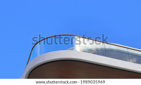 Balcony with curved glass balustrade Photo stock ©