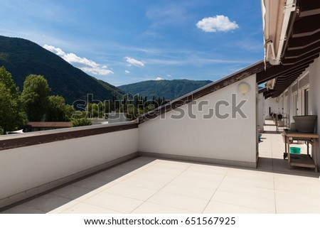 Balcony with hill view, nobody inside #651567925