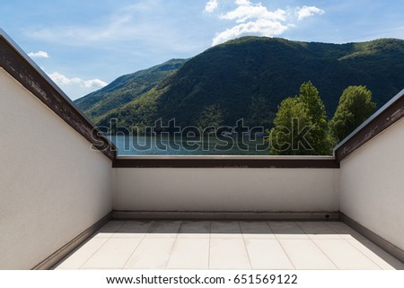 Balcony with lake view, nobody inside #651569122