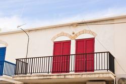 balcony with red doors