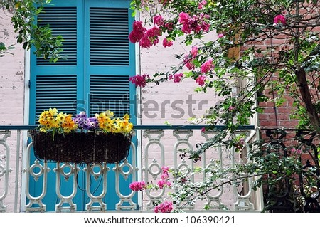 Balcony With Shuttered Doors, Railing And Flower Box