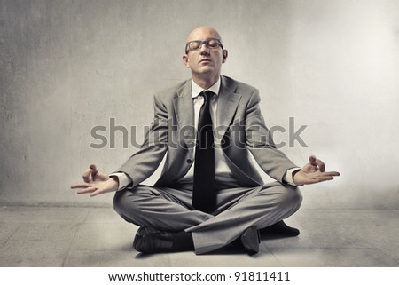 Bald businessman meditating
