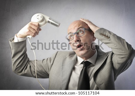 Bald businessman trying to dry his head
