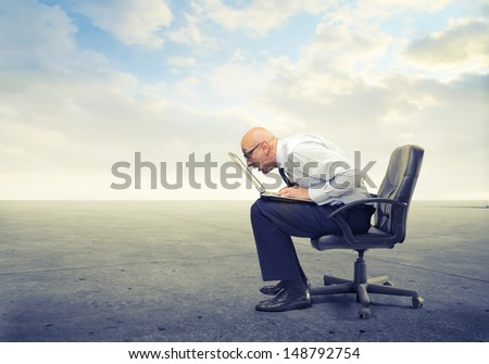bald businessman working very focused on the computer