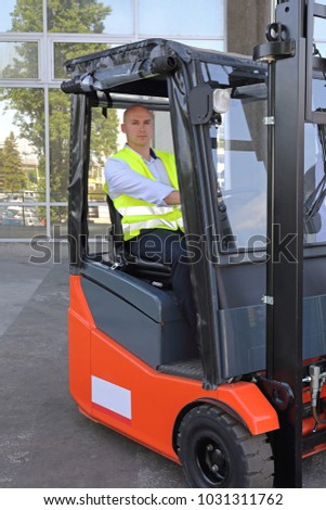 Bald Driver in Forklift Cabin With Rain Cover #1031311762