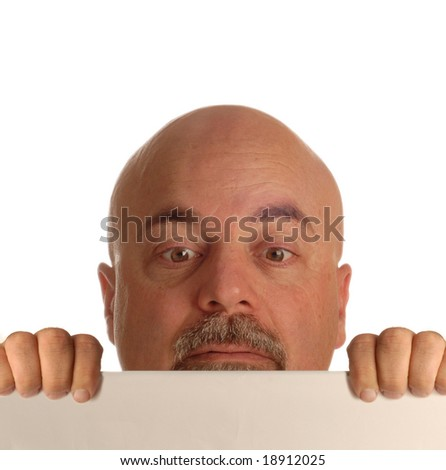 bald man holding up blank sign and straining to look over it