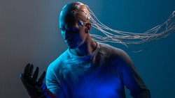 bald man with electrodes in his brain, a man of the future with technological additions, the brain is connected to virtual reality. man with a mechanical arm, augmentations
