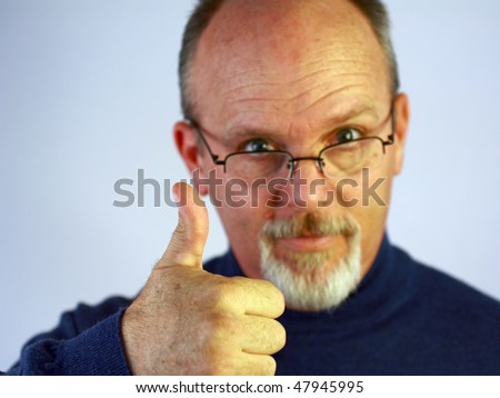 Bald man with glasses and thumb up