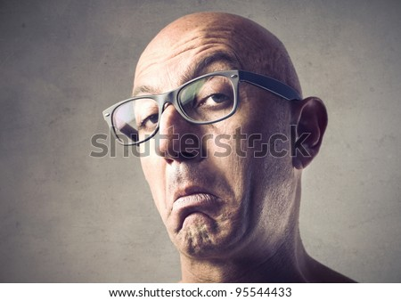Bald man with snobbish expression