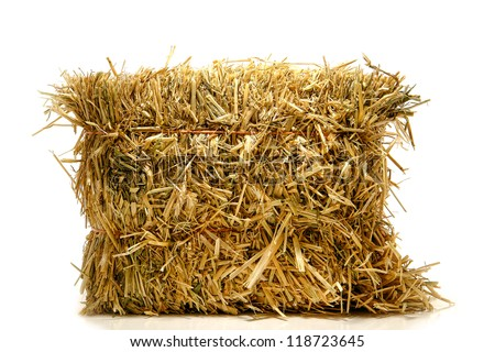 Bale of tied natural farming straw hay on white