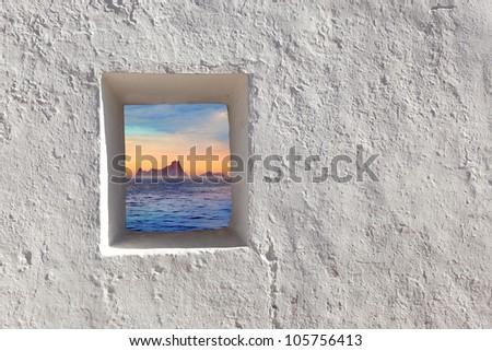 Balearic islands Es Vedra sunset view through whitewashed window [ photo-illustration]