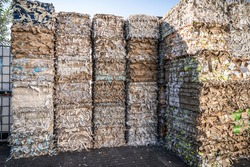 Bales of cardboard and box board with strapping wire ties recycling