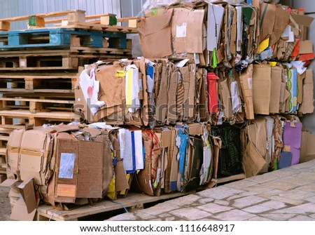 Bales of cardboard and box pile for recycling. Recycling cardboard packaging with stacks of compressed corrugated paper garbage to recycle for conservation and the environmental technology.