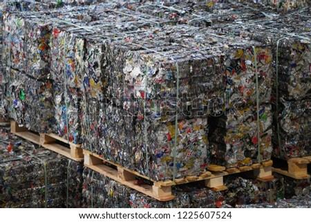 Bales of recyclable metal from aluminum beverage can waste.