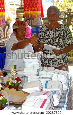 BALI _ APRIL 9 : Elderly Woman Voting, in only the second direct election since the fall of the Suharto dictatorship in 1998. Denpasar, Bali, Indonesia. April 9, 2009.