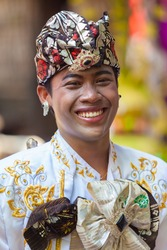 BALI - FEBRUARY 11. Man enacting wedding scene in preparation for religious ceremony on February 11, 2012 in Bali, Indonesia. Most Balinese get married in their early 20s.
