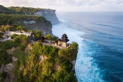 Bali, Indonesia, aerial view of Pura Luhur Uluwatu temple at sunrise.