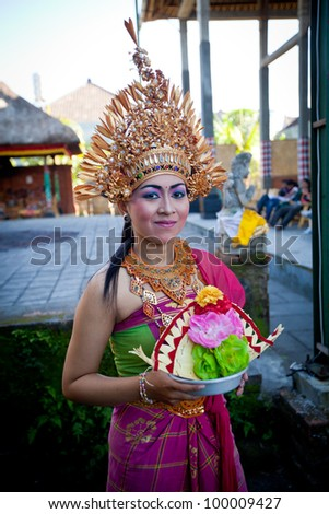 BALI, INDONESIA - APRIL 9: Balinese girl posing for turists before a classic national Balinese dance Barong on April 9, 2012 on Bali, Indonesia. Barong is very popular cultural show on Bali.