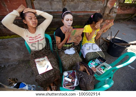 BALI, INDONESIA - APRIL 9: Balinese girls preparing for a classic national Balinese dance Barong on April 9, 2012 on Bali, Indonesia. Barong is very popular cultural show on Bali.