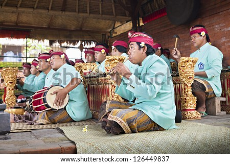 BALI, INDONESIA - APRIL 01: Musicians in the Gamelan troupe play traditional Balinese music to accompany dancers in a 'Barong Dance show' in Ubud village on April 01, 2011 in Bali, Indonesia.