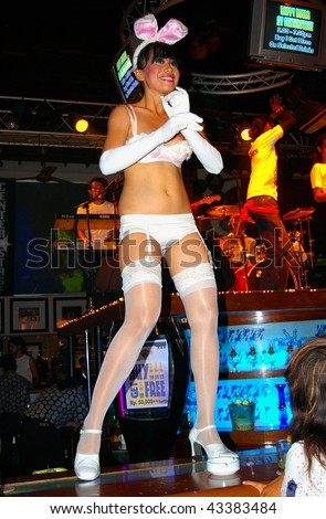 BALI, INDONESIA - AUGUST 22: Dancer dancing to live music at the Hard Rock Cafe on August 22, 2007 in Kuta, Bali. The amount of tourists who visit Bali is increasing rapidly, in 2008 it rose by 28.38%