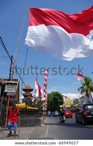 BALI, INDONESIA - AUGUST 17: Huge Indonesian flag on Independence day, August 17, 2010, Denpasar, the capital city of Bali, Indonesia. Independence day is the biggest national event of the year.