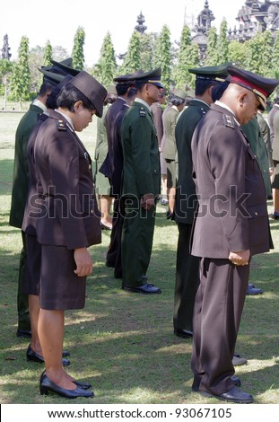 BALI, INDONESIA - AUGUST 17: Soldiers remembering those who died during struggle for Independence on August 17, 2010 in Renon Park, Denpasar, Bali. Independence day is the biggest event of the year.