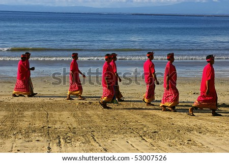 BALI, INDONESIA - JANUARY 22: Balinese men on the beach after a religious ceremony, January 22, 2008, Jimbaran, Bali. 93% of the people of Bali are Hindus, although Indonesia is predominantly Muslim.