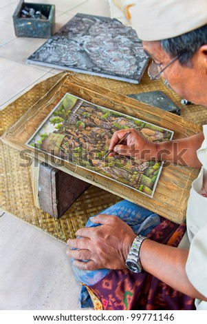 BALI,INDONESIA-JANUARY 23: Painter at work January 23. 2012 in Bali, Indonesia.Balinese paintings still show Javanese and Indian influences reflecting passages from stories such as Ramayana