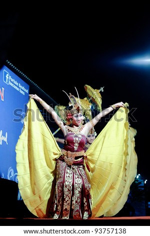 BALI, INDONESIA-JULY 4: A balinese traditional dancer entertains the crowd on July 4, 2009 in Jinbaran Beach, Bali, Indonesia. Bali is famous for its rich culture, Hindu festivals and dances