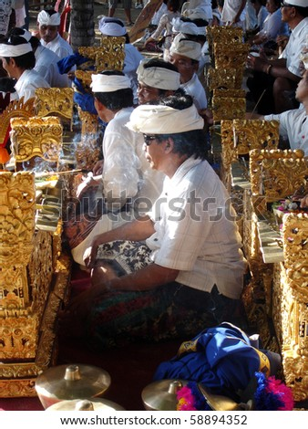 BALI, INDONESIA - JULY 1: Balinese men play the ancient musical ensemble of Gamelan in the Bali Arts Festival, July 1, 2010, Kuta, Bali. Gamelan players participate in the Gong Kebyar competition.