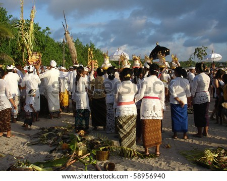 BALI, INDONESIA - JULY 1: Balinese pilgrims attending a religious ceremony on the beach, July 1, 2010, Kuta beach, Bali. The ceremony takes place each year at the start of the Bali Arts festival.