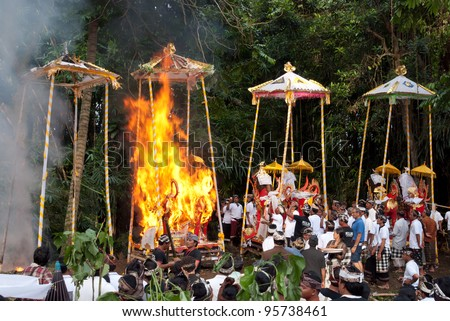 BALI, INDONESIA, JULY 14: Funeral pyres in the form of a bull are set on fire during a cremation ceremony in Penestanan, Bali on July 14th 2010.