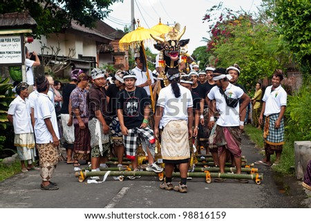BALI, INDONESIA, JULY 14: unidentified Balinese people preparing for the parade during the cremation ceremony in Penestanan, Bali on July 14th 2010.