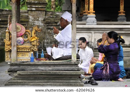 BALI, INDONESIA - JUNE 22: A group of Hindu believers came to the 2nd biggest Hindu temple in Bali Island to pray and to give offering to God, June 22, 2010 in Bali, Indonesia.
