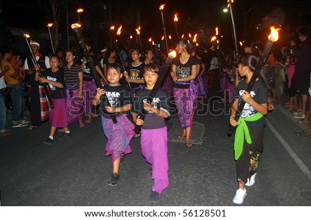 BALI, INDONESIA - MARCH 15: Balinese Hindu festival of Pengrupukan in Legian, Bali, March 15, 2010. The annual festival is to roust out the devils which have gone into hiding on the island.
