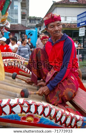 BALI, INDONESIA - MARCH 7: Gamelan player participates in the annual Balinese festival of Pengrupukan, March 7, 2008, Denpasar, Bali. This celebrates the Balinese New Year and the arrival of spring.