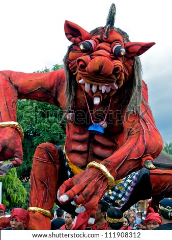 BALI, INDONESIA - MARCH 15: Hindu festival of Pengrupukan March 15, 2010 in Bali. This celebrates the Balinese New Year and the arrival of spring. Over 4000 giant monsters are carried on the streets