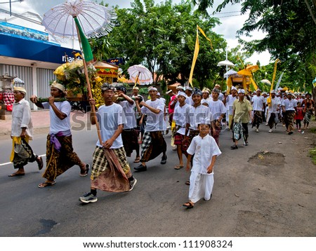 BALI, INDONESIA - MARCH 14: Hindu festival of Pengrupukan March 14, 2010 in Bali. This celebrates the Balinese New Year and the arrival of spring. This is a  procession to the village temple - stock photo
