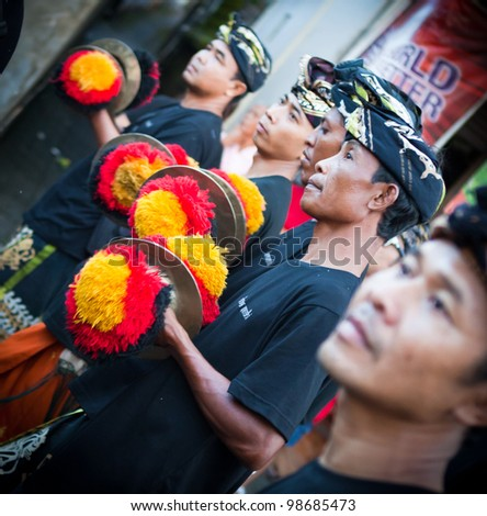 BALI, INDONESIA - MARCH 22: Hindu festival of Pengrupukan March 22, 2012 in Bali. This celebrates the Balinese New Year and the arrival of spring. - stock photo