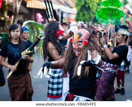 BALI, INDONESIA - MARCH 22: Hindu festival of Pengrupukan March 22, 2012 in Bali. This celebrates the Balinese New Year and the arrival of spring.