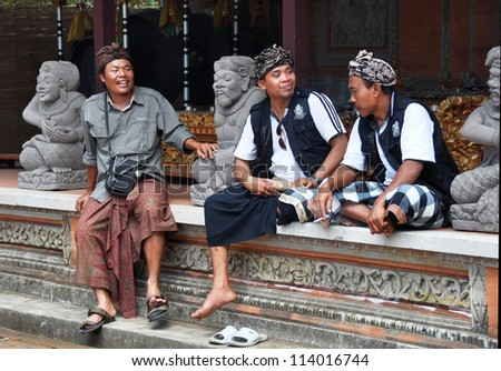 BALI, INDONESIA - OCTOBER 07: Balinese men at a religious festival in Celuk. They are wearing traditional religious black and white (Hindu evil & good spirits) fabric. on October 07,2011 in Bali.