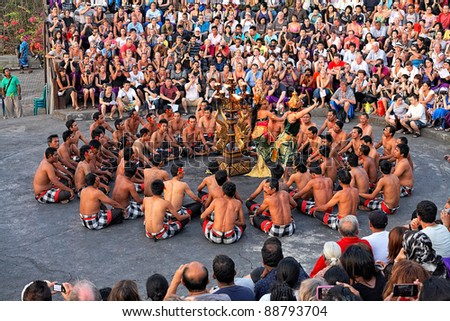 BALI, INDONESIA - OCTOBER 25: Unidentified dancers participate in a Balinese Kecak dance also known as the Ramayana Monkey Chant on October 25, 2011 at  temple Uluwatu, Bali, Indonesia
