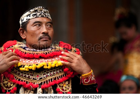 BALI - JANUARY 15: Actor dressing up to prepare for his role in play called 'Topeng Tua' to welcome guests to his village. January 15, 2010 in Bali, Indonesia.