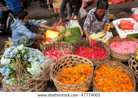 BALI - JANUARY 17: Commercial activities in the main Ubud market, showing florist sells flower products, Bali January 17, 2010 in Bali, Indonesia.