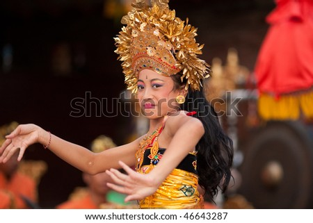 BALI - JANUARY 15: Young Balinese girl performs a welcome dance in a 'full moon ceremony' in the Bedulu village in Ubud, Bali. January 15, 2010 in Bali, Indonesia.