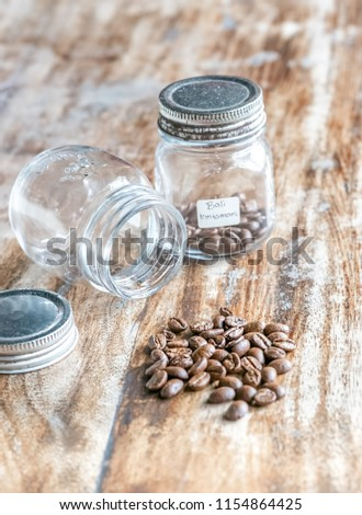 Bali Kintamani Coffee Bean On Glass Jar Are Being Inspected On The Wooden Table