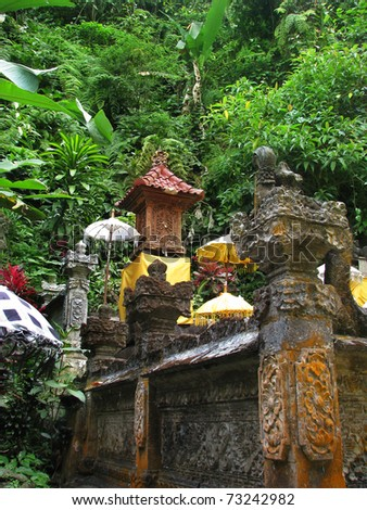 Bali: lovely and peaceful temple surrounded by wild nature, near Gitgit waterfalls. North Bali, Indonesia